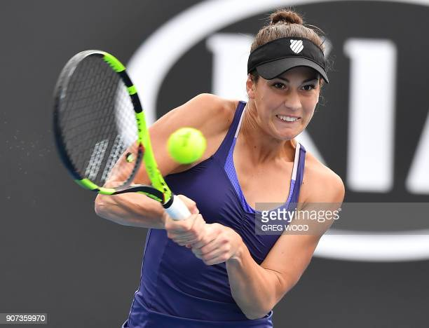 Bernarda Pera of the US plays a backhand return to Czech Republic's Barbora Strycova during their women's singles third round match on day six of the...