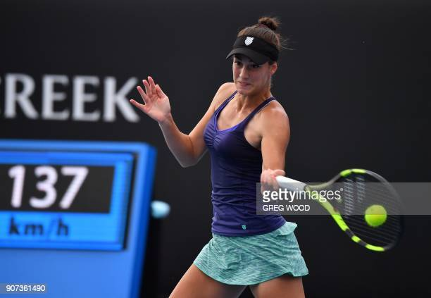 Bernarda Pera of the US plays a forehand return to Czech Republic's Barbora Strycova during their women's singles third round match on day six of the...