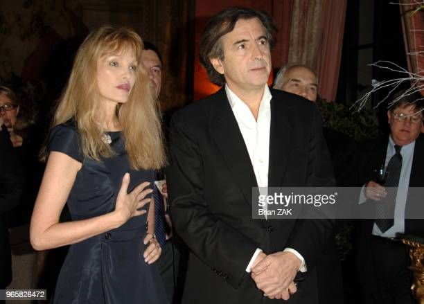 BernardHenri Levy and Arielle Dombasle arrive at the French Consulate prior to Levy delivering remarks on his new book 'American Vertigo Traveling...