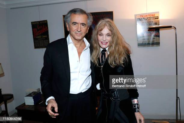 BernardHenri Levy and his wife Arielle Dombasle pose after BernardHenri Levy performed in Looking for Europe at Theatre Antoine on May 21 2019 in...