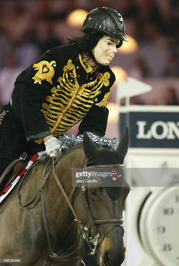 Bernardo Alves of Brazil rides as Michael Jackson during the 'Style and Competition' show jumping charity event benefitting 'AMADE' on day three of the Longines Paris Masters 2015 held at the Paris-Nord Villepinte Exhibition Center on December 5, 2015 in Villepinte nearby Paris, France.