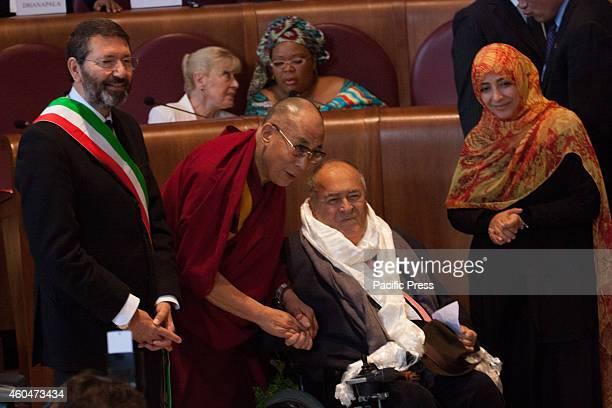 Bernardo Bertolucci receives an award for his work from the Dalai Lama Ignazio Marino and Mrs Karman on the closing day of the World Summit of Nobel...