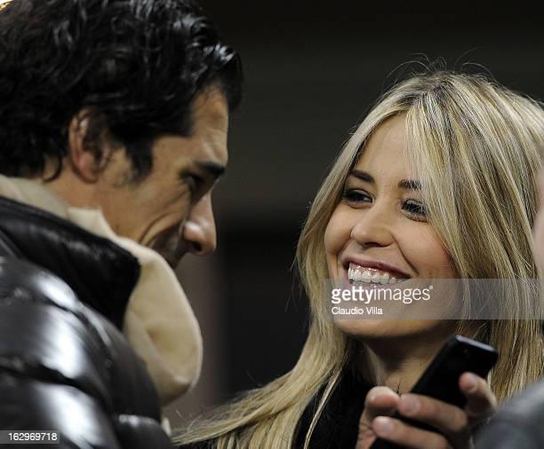 Bernardo Corradi and Elena Santarelli attend the Serie A match between AC Milan and S.S. Lazio at San Siro Stadium on March 2, 2013 in Milan, Italy.