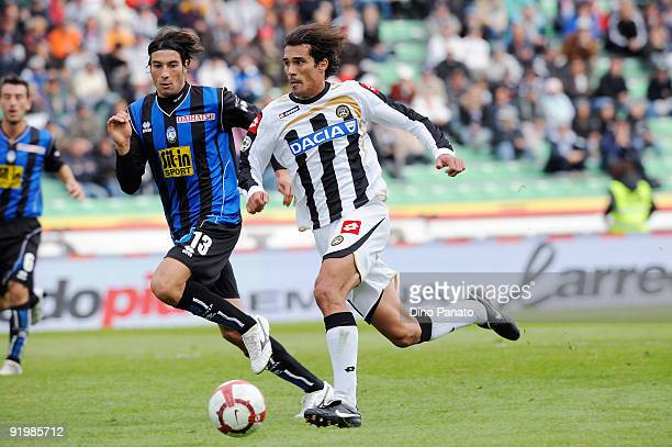Bernardo Corradi of Udinese Calcio competes in thr air with Maximiliano Pellegrino of Atalanta BC during the Serie A match between Udinese Calcio and...