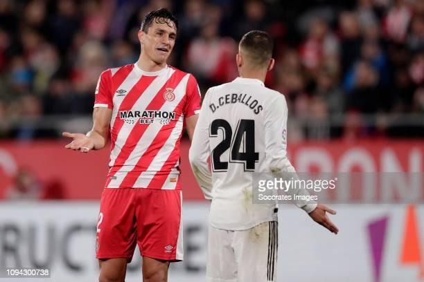 Bernardo Espinosa of Girona, Dani Ceballos of Real Madrid during the Spanish Copa del Rey match between Girona v Real Madrid at the Estadi Municipal...