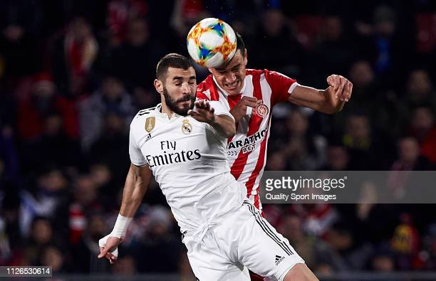 Bernardo Espinosa of Girona FC competes for the ball with Karim Benzema of Real Madrid during the Copa del Rey second leg Quarter Final match between...