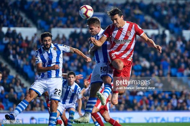Bernardo Espinosa of Girona FC competes for the ball with Kevin Rodrigues of Real Sociedad during the La Liga match between Real Sociedad and Girona...