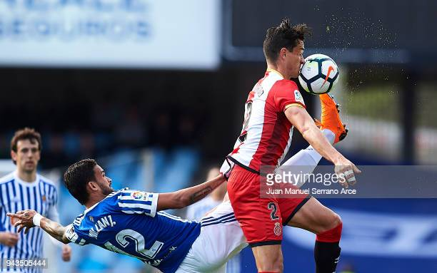 Bernardo Espinosa of Girona FC duels for the ball with Willian Jose Da Silva of Real Sociedad during the La Liga match between Real Sociedad de...