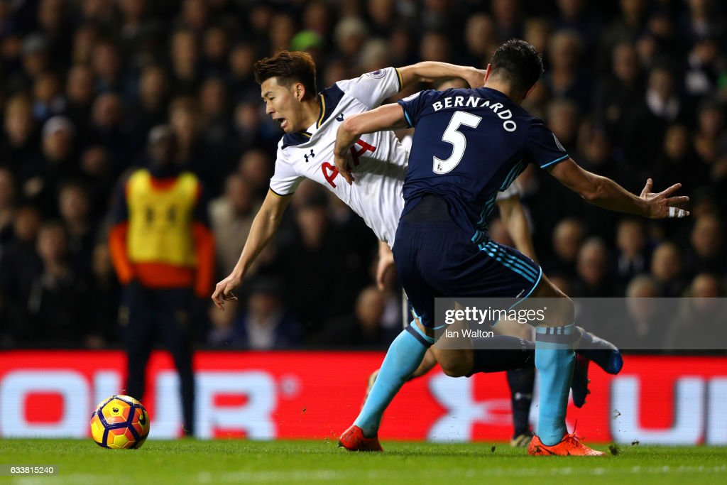 Bernardo Espinosa of Middlesbrough fouls Son Heung-Min of Tottenham Hotspur and concedes a penalty during the Premier League match between Tottenham Hotspur and Middlesbrough at White Hart Lane on February 4, 2017 in London, England.