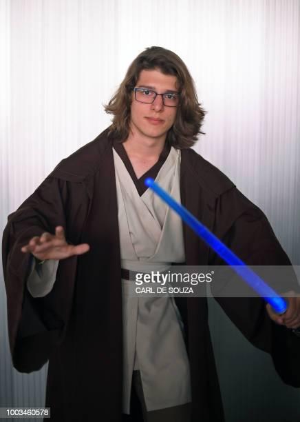 Bernardo Felisdorio Espindola wears a costume resembling a Jedi character from the Star Wars saga at The Geek and Game Expo in Rio de Janeiro on July...