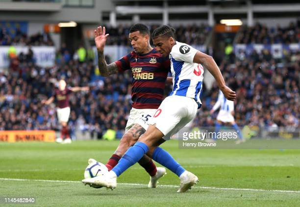 Bernardo Fernandes da Silva of Brighton and Hove Albion is blocked by Kenedy of Newcastle United during the Premier League match between Brighton...