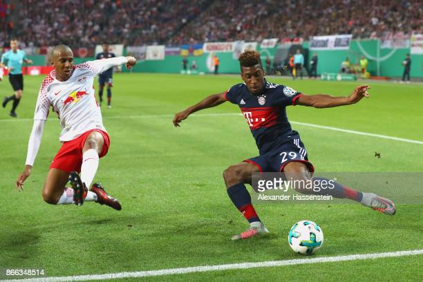 Bernardo Fernandes da Silva of Leipzig battles for the ball with Kingsley Coman of Bayern Muenchen during the DFB Cup round 2 match between RB...