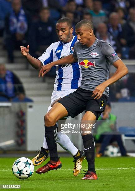 Bernardo Fernandes Da Silva of RB Leipzig is challenged by Ricardo Pereira of FC Porto during the UEFA Champions League group G match between FC...