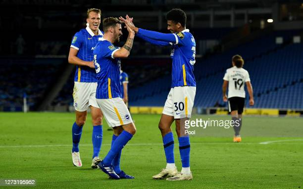 Bernardo of Brighton and Hove Albion celebrates with teammate Pascal Gross after scoring his sides third goal during the Carabao Cup second round...