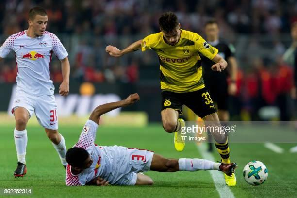 Bernardo of Leipzig and Julian Weigl of Dortmund battle for the ball during the Bundesliga match between Borussia Dortmund and RB Leipzig at Signal...