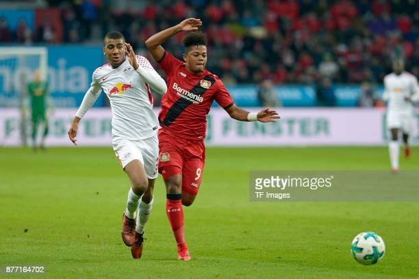 Bernardo of Leipzig and Leon Bailey of Leverkusen battle for the ball during the Bundesliga match between Bayer 04 Leverkusen and RB Leipzig at...