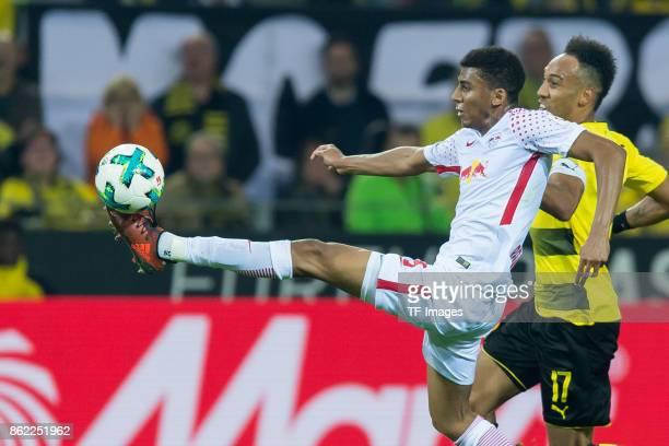 Bernardo of Leipzig and PierreEmerick Aubameyang of Dortmund battle for the ball during the Bundesliga match between Borussia Dortmund and RB Leipzig...