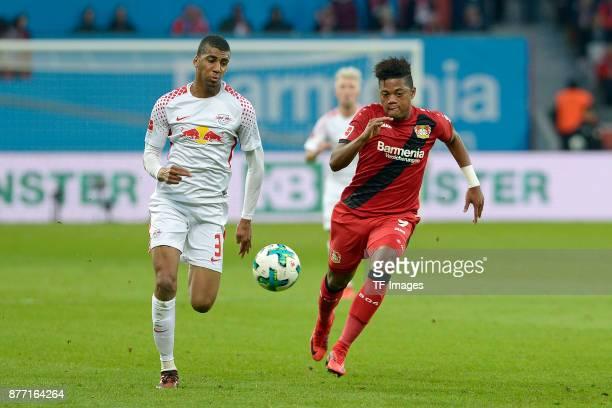 Bernardo of Leipzig and Wendell of Leverkusen battle for the ball during the Bundesliga match between Bayer 04 Leverkusen and RB Leipzig at BayArena...