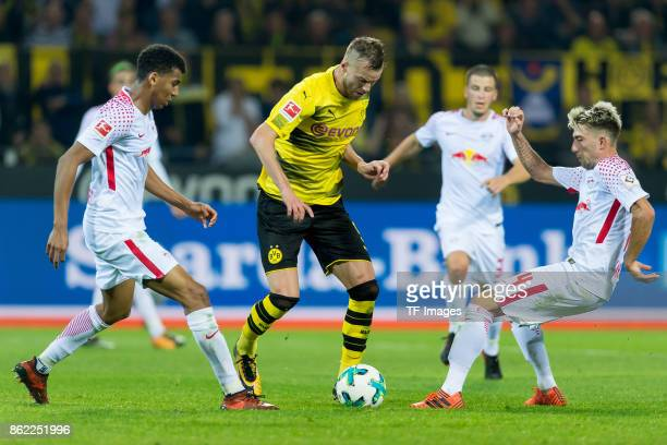 Bernardo of Leipzig Andrey Yarmolenko of Dortmund and Kevin Kampl of Leipzig battle for the ball during the Bundesliga match between Borussia...