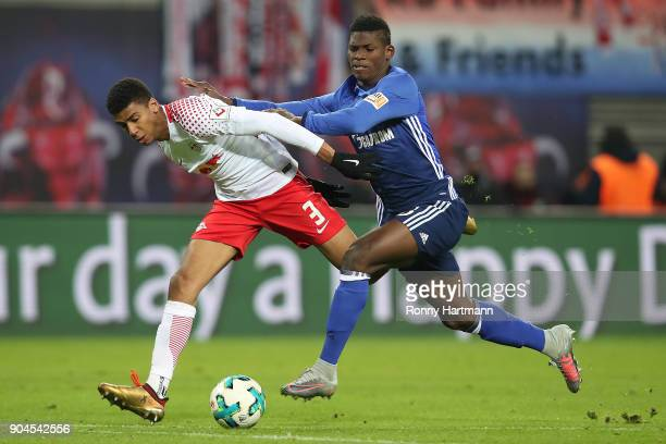 Bernardo of Leipzig fights for the ball with Breel Embolo of Schalke during the Bundesliga match between RB Leipzig and FC Schalke 04 at Red Bull...