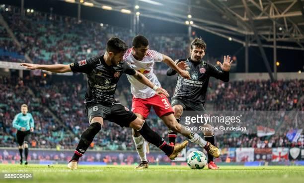 Bernardo of RB Leipzig in action with Danny Latza of 1 FSV Mainz 05 and Giulio Donati of 1 FSV Mainz 05 during the Bundesliga match between RB...
