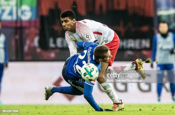Bernardo of RB Leipzig in action with Marko Pjaca of FC Schalke 04 during the Bundesliga match between RB Leipzig and FC Schalke 04 at Red Bull Arena...