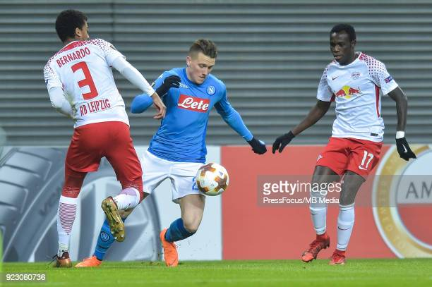 Bernardo of RB Leipzig Piotr Zielinski of Napoli and Bruma of RB Leipzig during UEFA Europa League Round of 32 match between RB Leipzig and Napoli at...