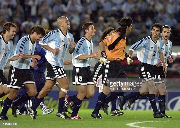 Bernardo RomeoClaudio LopezJuan Veron Javier Zanetti German BurgosRoberto Ayala and Mauricio Pocchettino are seen heading into the field in Buenos...