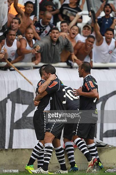 Bernardo Romulo Diego Souza and Alecsandro of Vasco da Gama celebrate a scored goal againist Fluminense during a match as part of Serie A 2011 at...