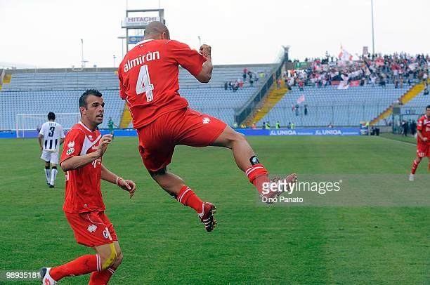 Bernardo Sergio Almiron of Bari celebrates after scoring with teammate Riccardo Meggiorini during the Serie A match between Udinese Calcio and AS...