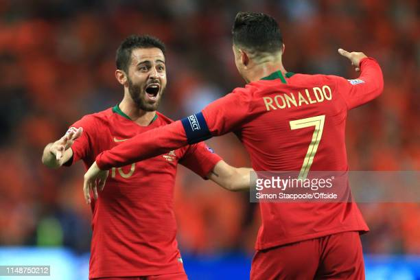 Bernardo Silva and Cristiano Ronaldo of Portugal celebrate winning the Nations League during the UEFA Nations League Final between Portugal and the...