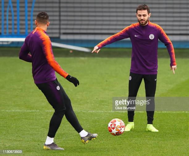 Bernardo Silva and Danilo pass the ball during a Manchester City training session at Manchester City Football Academy on February 19 2019 in...