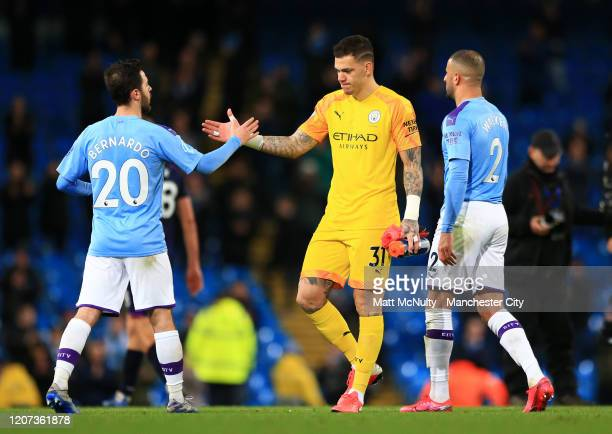 Bernardo Silva and Ederson of Manchester City celebrate following their sides victory in during the Premier League match between Manchester City and...