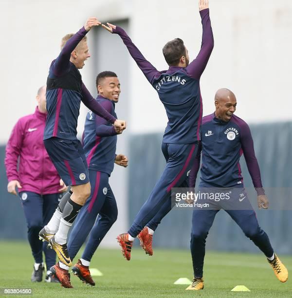 Bernardo Silva and Oleksandar Zinchenko celebrate during training at Manchester City Football Academy on October 20 2017 in Manchester England