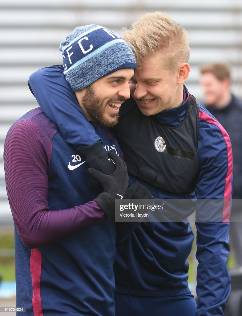 Bernardo Silva and Oleksandr Zinchenko joke as they walk to training at Manchester City Football Academy on February 8, 2018 in Manchester, England.