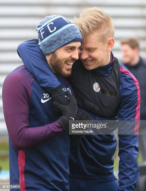 Bernardo Silva and Oleksandr Zinchenko joke as they walk to training at Manchester City Football Academy on February 8 2018 in Manchester England