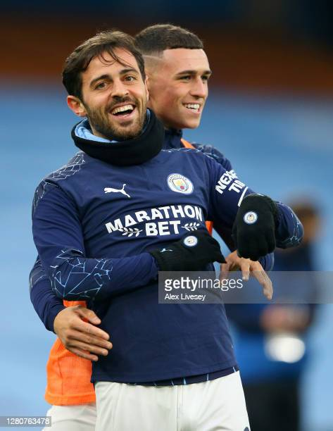 Bernardo Silva and Phil Foden of Manchester City smile prior to the Premier League match between Manchester City and Arsenal at Etihad Stadium on...