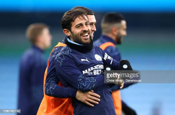 Bernardo Silva and Phil Foden of Manchester City warm up ahead of the Premier League match between Manchester City and Arsenal at Etihad Stadium on...
