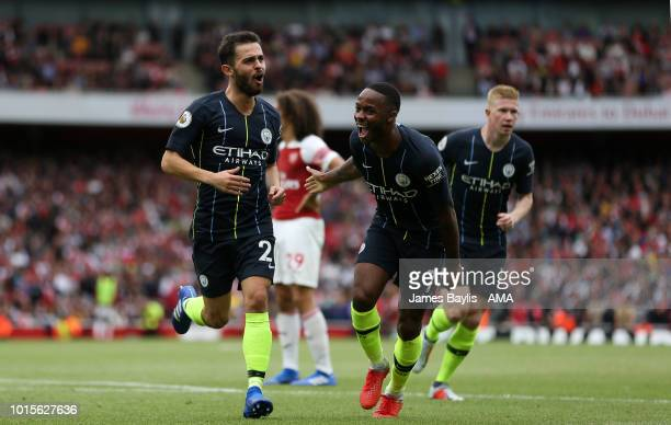 Bernardo Silva celebrates with Raheem Sterling of Manchester City after scoring a goal to make it 02 during the Premier League match between Arsenal...