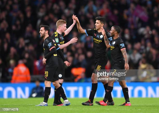 Bernardo Silva Kevin De Bruyne Rodrigo and Raheem Sterling of Manchester City celebrate following victory in the Carabao Cup Final between Aston...