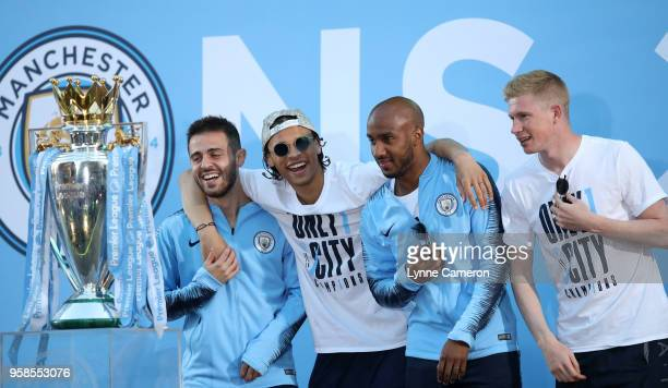 Bernardo Silva Leroy Sane Fabian Delph and Kevin De Bruyne of Manchester City during the Manchester City Trophy Parade in Manchester city centre on...