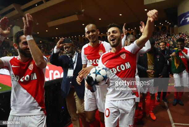 Bernardo Silva of AS Monaco celebrates victory with team mates Joao Moutinho and Fabinho after the UEFA Champions League Round of 16 second leg match...