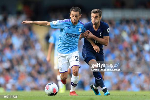 Bernardo Silva of Man City battles with Harry Winks of Spurs during the Premier League match between Manchester City and Tottenham Hotspur at the...