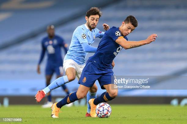 Bernardo Silva of Man City battles with Mateus Uribe of Porto during the UEFA Champions League Group C match between Manchester City and FC Porto at...