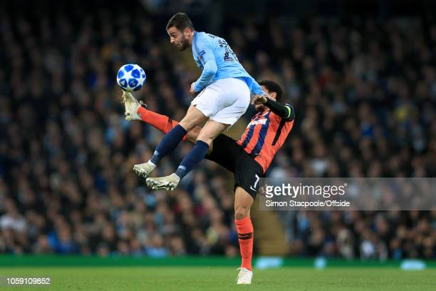 Bernardo Silva of Man City battles with Taison of Shakhtar during the Group F match of the UEFA Champions League between Manchester City and Shakhtar...