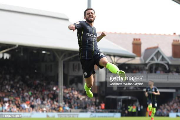 Bernardo Silva of Man City celebrates scoring the opening goal during the Premier League match between Fulham FC and Manchester City at Craven...
