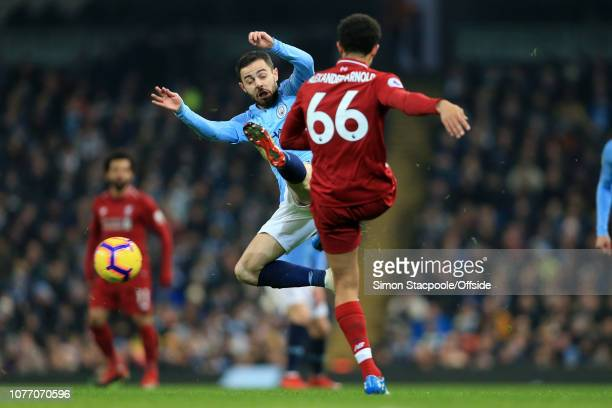 Bernardo Silva of Man City charges down a pass from Trent AlexanderArnold of Liverpool during the Premier League match between Manchester City and...