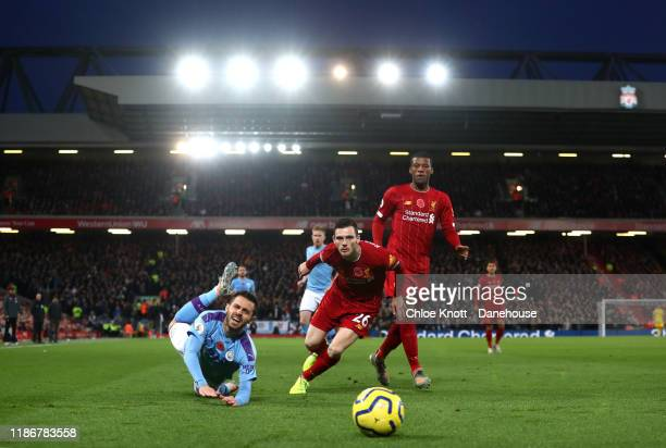 Bernardo Silva of Manchester City and Andy Robertson of Liverpool in action during the Premier League match between Liverpool FC and Manchester City...