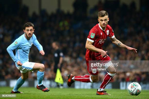 Bernardo Silva of Manchester City and Jamie Paterson of Bristol City during the Carabao Cup SemiFinal First Leg match between Manchester City and...