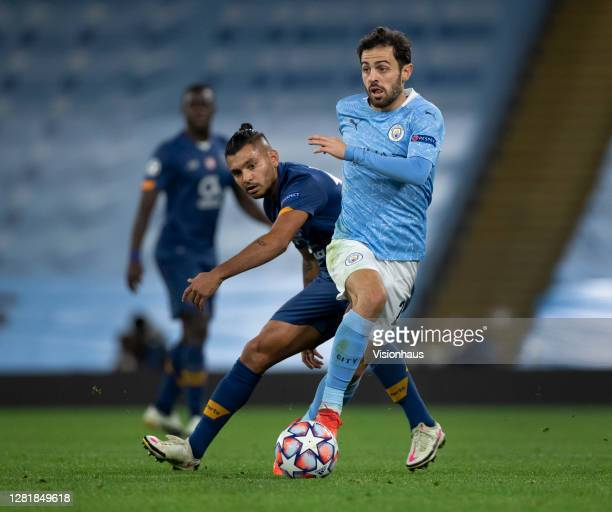 Bernardo Silva of Manchester City and Jesus Corona of FC Porto in action during the UEFA Champions League Group C stage match between Manchester City...